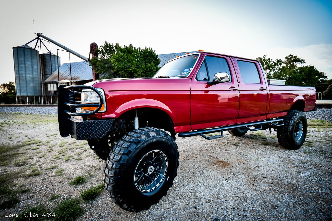 '97 Custom Lifted Ford F250 Drivers Side
