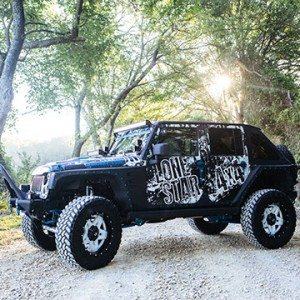 Lonestar 4x4 Jeep with Custom Top Drivers Side View