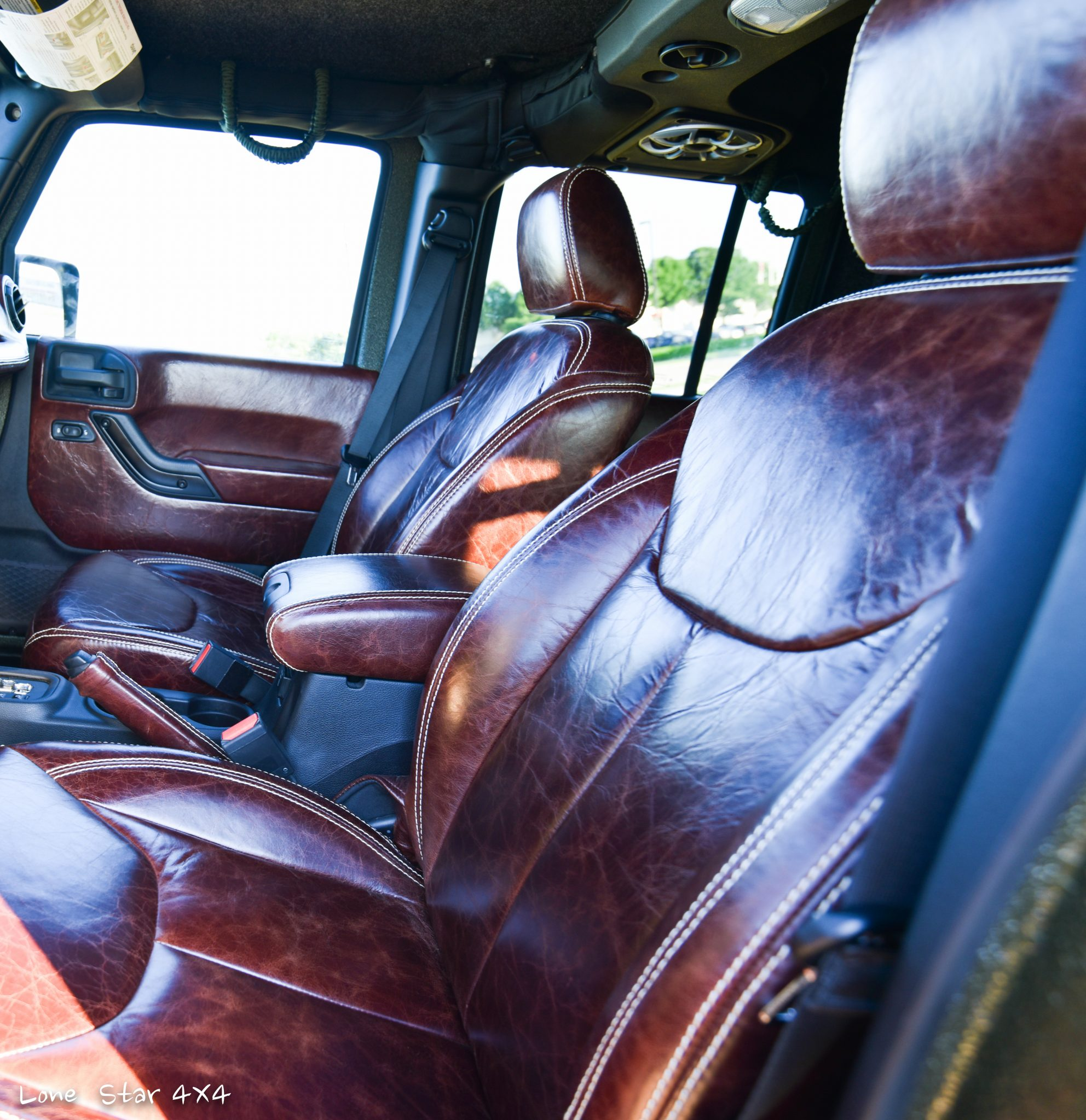 Custom Leather Captains Chairs in RIPP Supercharged Jeep