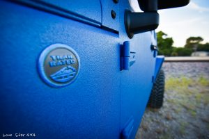 Sprayed Blue Jeep Rubicon Trail Rated Emblem