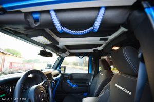 Sprayed Blue Jeep Rubicon Interior Leather and Grab Handles