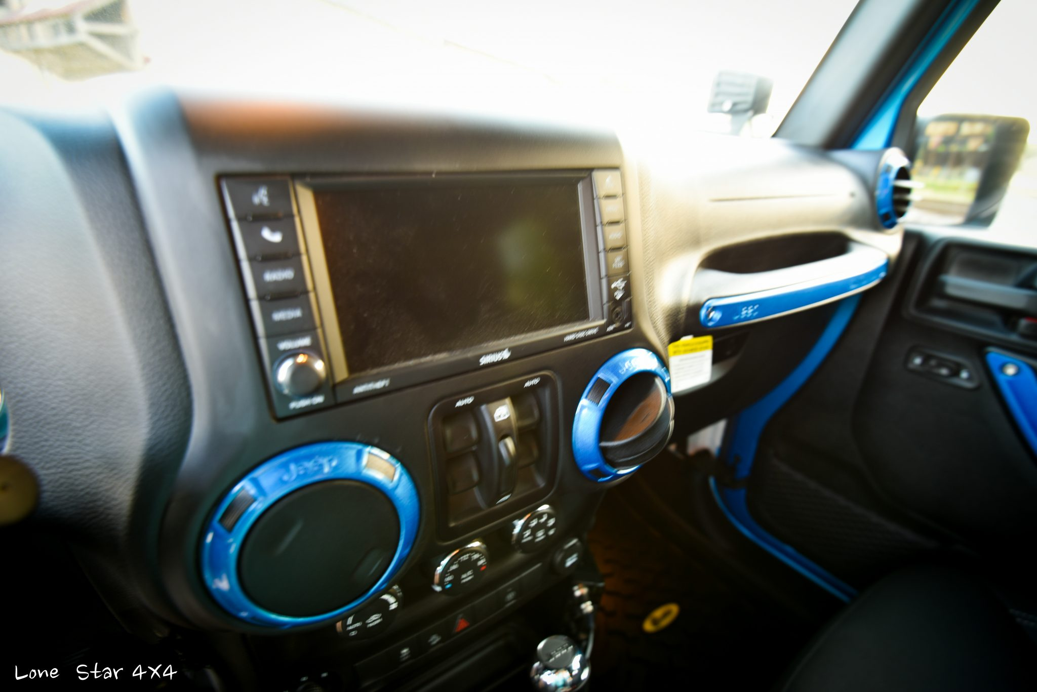 Sprayed Blue Jeep Rubicon Navigation System and Radio