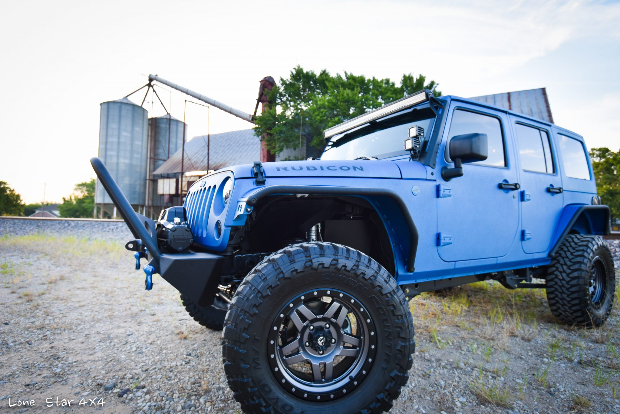 Sprayed Blue Jeep Rubicon Drivers Side Exterior View