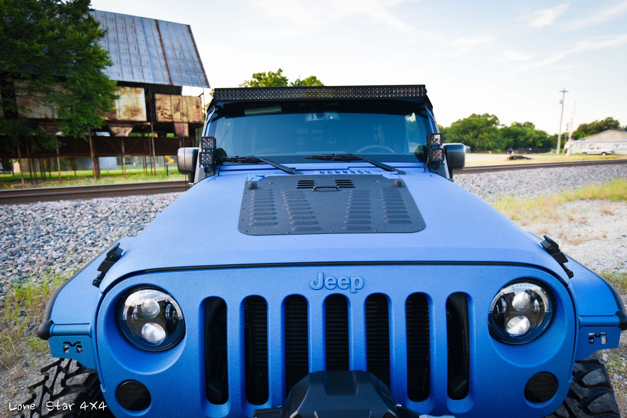 Sprayed Blue Jeep Rubicon Front Hood and Windshield View