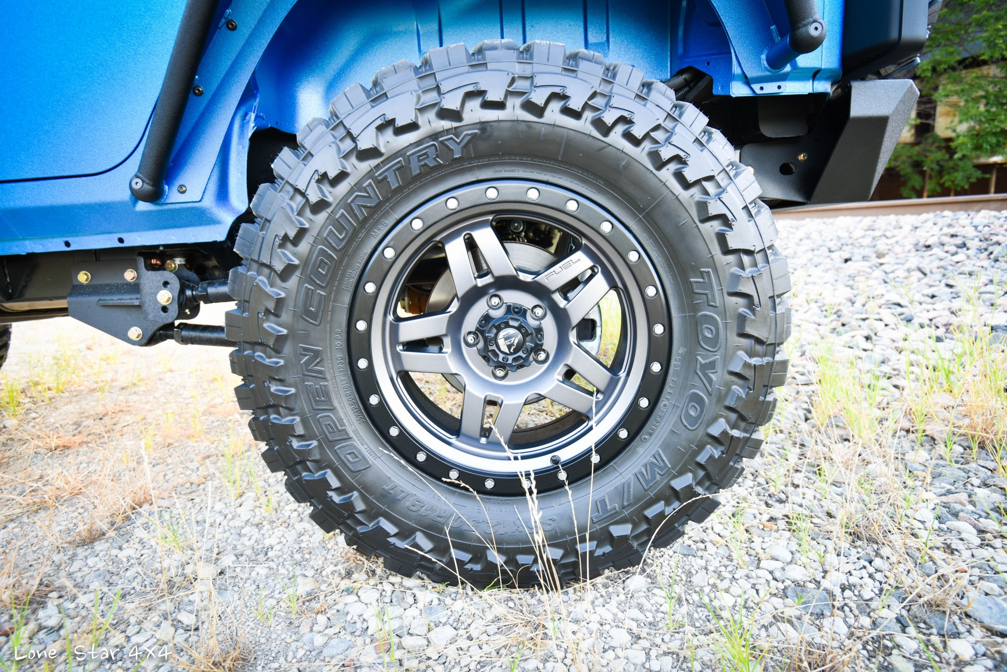 Sprayed Blue Jeep Rubicon Toyo Tires