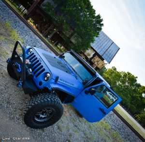 Sprayed Blue Jeep Rubicon Front View with Open Drivers Side Door