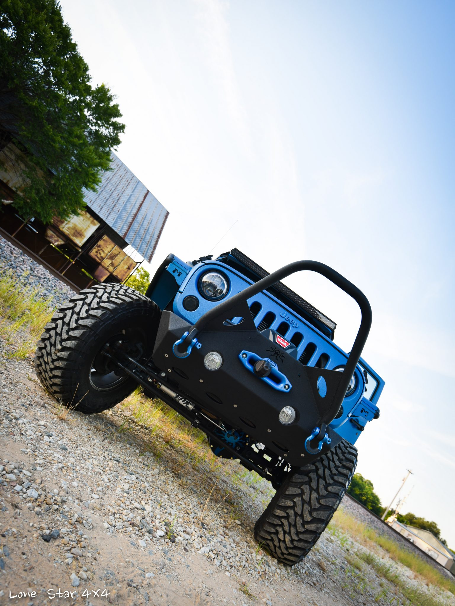 Sprayed Blue Jeep Rubicon Front View of Tires and Grille Guard