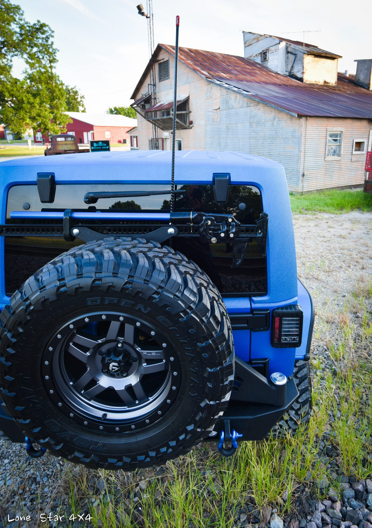 Sprayed Blue Jeep Rubicon Rear Elevated View