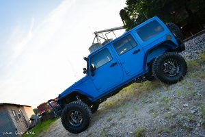 Sprayed Blue Jeep Rubicon Drivers Side Full Body View