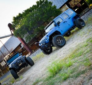 Sprayed Blue Jeep Rubicon and Grey Jeep drivers Side View