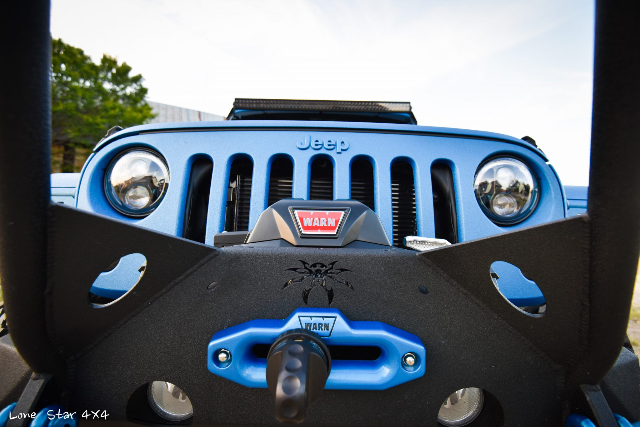 Sprayed Blue Jeep Rubicon Grille Guard Close Up