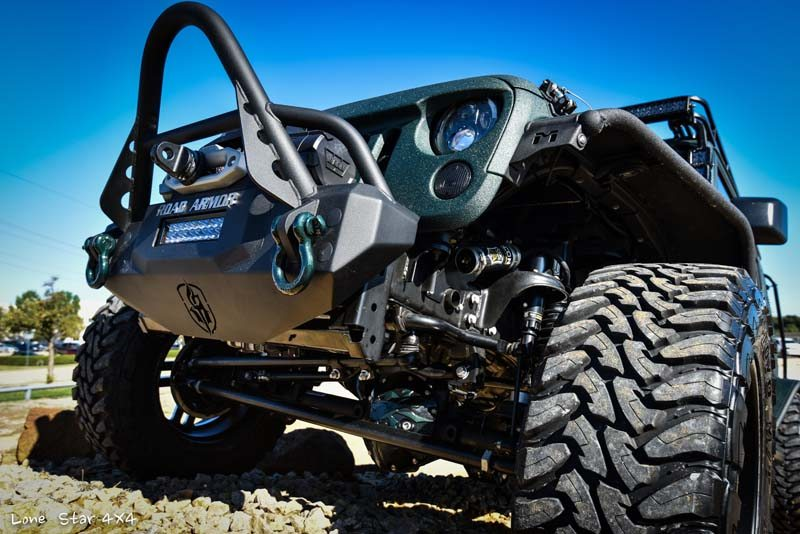 Jaguar Green Jeep Wrangler Front Tire and Bumper