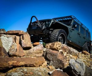 Jaguar Green Jeep Wrangler on Rock Pile