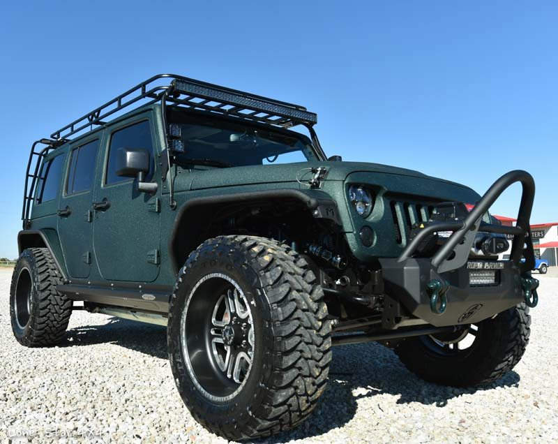 Jaguar Green Jeep Wrangler Front Passenger Side