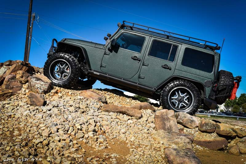 Jaguar Green Jeep Wrangler Drivers Side View