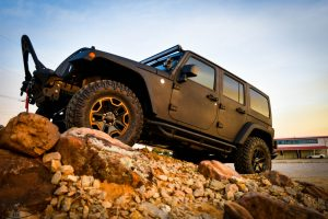 Midnight Edition Jeep On Rock Pile Drivers Side View
