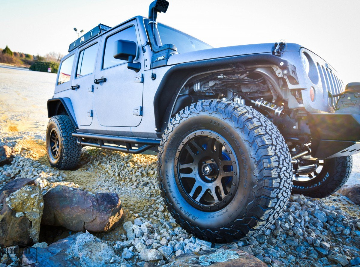 Silver Custom Jeep Wrangler Passenger Side View on Rock Pile