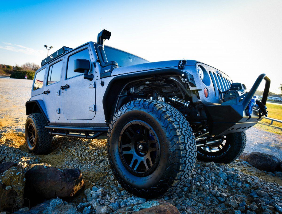 Silver Custom Jeep Wrangler On Rock Pile