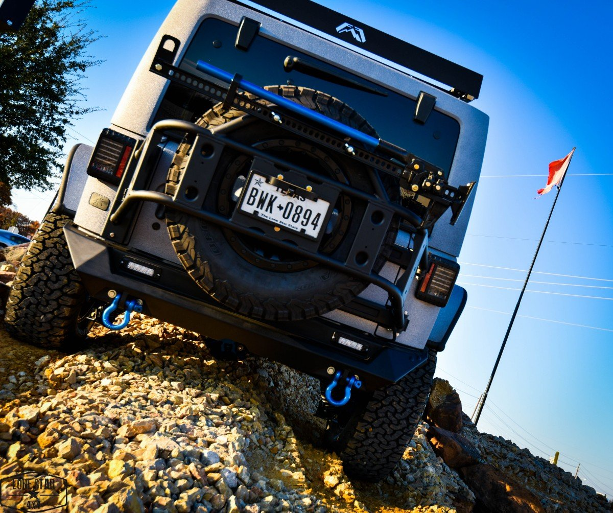 Silver Custom Jeep Wrangler Rear View on Incline